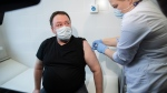 A medical worker administers a shot of Russia's Sputnik V coronavirus vaccine in Moscow, Russia, Tuesday, April 27, 2021. (AP Photo/Pavel Golovkin)