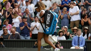 Japan's Naomi Osaka leaves the court after losing to Kazakstan's Yulia Putintseva in a Women's singles match during day one of the Wimbledon Tennis Championships in London, Monday, July 1, 2019. (AP Photo/Kirsty Wigglesworth)