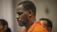FILE - In this Sept. 17, 2019, file photo, R. Kelly appears during a hearing at the Leighton Criminal Courthouse in Chicago. U.S. District Judge Ann Donnelly signaled on Thursday, June 17, 2021, that the jailed R&B singer will likely get to keep his new defense team for his sex-trafficking trial, despite questions about his attorney's communications with one of Kelly's ex-girlfriends. (Antonio Perez/Chicago Tribune via AP, Pool, File)