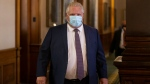Ontario Premier Doug Ford walks into the Legislative chamber at Queens Park, in Toronto, on Monday June 14, 2021. A vote is expected this afternoon on legislation that would limit third-party advertising during Ontario elections. THE CANADIAN PRESS/Chris Young