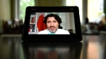 Prime Minister Justin Trudeau is seen on an iPad during a virtual news conference on the COVID-19 pandemic from his residence at Rideau Cottage in Ottawa, Friday, June 18, 2021. THE CANADIAN PRESS/Justin Tang