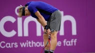 Denis Shapovalov of Canada reacts after he plays a return to Cameron Norrie of Britain during their semifinal singles tennis match at the Queen's Club tournament in London, Saturday, June 19, 2021. (AP Photo/Kirsty Wigglesworth)