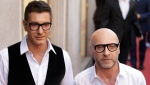 FILE - In this Thursday, May 19, 2011 file photo, fashion designers Stefano Gabbana, left, and Domenico Dolce arrive in downtown Milan, Italy. (AP Photo/Luca Bruno, File)