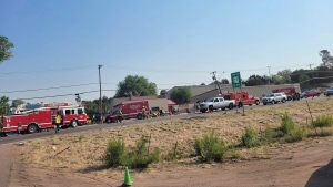 This Saturday, June 19, 221, photo released by the Timber Mesa Fire and Medical District shows emergency personnel at the scene of a mass casualty incident near Downtown 9 in Show Low, Ariz., Saturday, June 19, 2021. Police say a driver in a pickup truck has plowed into bicyclists competing in a community road race in Arizona, critically injuring several riders. (Timber Mesa Fire and Medical District via AP)