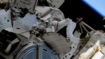 In this image taken from NASA video, French astronaut Thomas Pesquet, left, and NASA astronaut Shane Kimbrough venture out on a spacewalk outside the International Space Station on Wednesday, June 16, 2021. (NASA via AP)