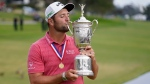 Jon Rahm, of Spain, kisses the champions trophy for photographers after the final round of the U.S. Open Golf Championship, Sunday, June 20, 2021, at Torrey Pines Golf Course in San Diego. (AP Photo/Marcio Jose Sanchez)