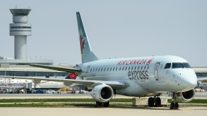 A grounded Air Canada planes sits on the tarmac at Pearson International Airport during the during the COVID-19 pandemic in Toronto on Tuesday, April 27, 2021. THE CANADIAN PRESS/Nathan Denette
