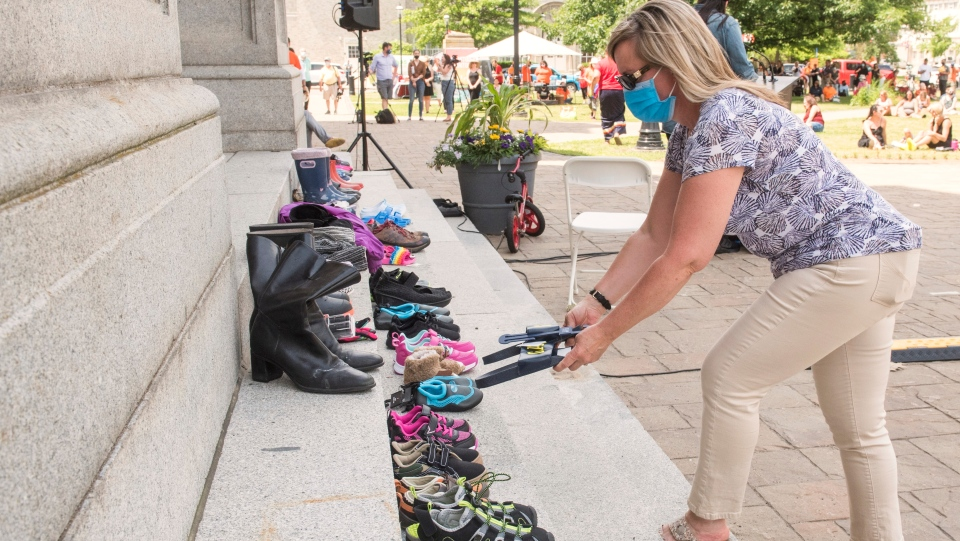 People placed children's shoes on the front stairs of the New Brunswick legislature as a memorial for the 215 children found at the Kamloops Residential School as part of National Indigenous Peoples Day in Fredericton, N.B., on Monday June 21, 2021. THE CANADIAN PRESS/Stephen MacGillivray
