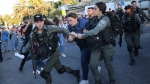 Israeli forces arrest Al Jazeera journalist, Givara Budeiri, during a protest in the east Jerusalem neighborhood of Sheikh Jarrah, Saturday, June 5, 2021. (AP Photo/Oren Ziv)