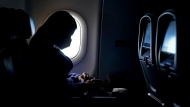 """In this Feb. 3, 2021, file photo, a passenger wears a face mask she travels on a Delta Air Lines flight after taking off from Hartsfield-Jackson International Airport in Atlanta.  Airlines have reported about 3,000 cases of disruptive passengers since Jan. 1, according to a spokesman for the Federal Aviation Administration. It has gotten so bad that the airlines, flight attendants and pilots sent a letter to the U.S. Justice Department on Monday, June 21, urging """"that more be done to deter egregious behavior."""" (AP Photo/Charlie Riedel, File)"""