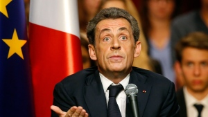 FILE - In this Oct.6, 2014 file photo, former French President Nicolas Sarkozy speaks during a campaign meeting for the leadership of the conservative UMP party in Velizy, west of Paris. The trial of former French President Nicolas Sarkozy concludes Tuesday in Paris, after a month during which the court sought to determine whether he broke laws on campaign financing in his unsuccessful 2012 re-election bid. (AP Photo/Michel Euler, File)