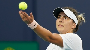 Bianca Andreescu, of Canada, serves to Amanda Anisimova during the Miami Open tennis tournament, Sunday, March 28, 2021, in Miami Gardens, Fla. (AP Photo/Wilfredo Lee)