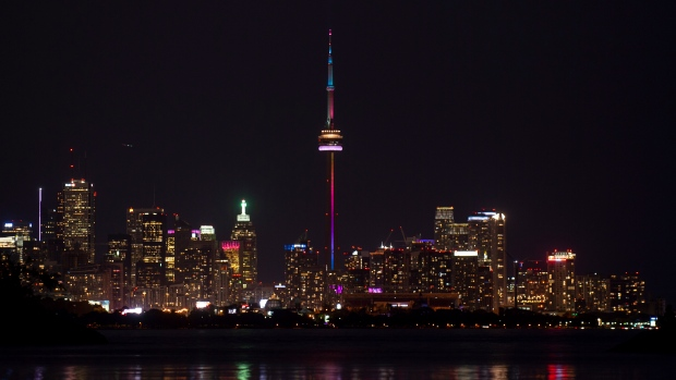 The CN Tower is lit up in a rainbow during Canada Day celebrations in Toronto on Monday, July 1, 2019. THE CANADIAN PRESS/Andrew Lahodynskyj
