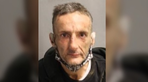 Toronto resident Douglas MacDonald is wanted for allegedly assaulting a woman in her apartment last month.