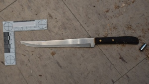One of the weapons that was possessed by 46-year-old Gedi Ali Gedi on the morning that he was fatally shot by police in his apartment is shown. (Special Investigations Unit)