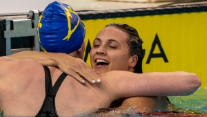 Kylie Masse (right) is congratulated by Ingrid Wilm after winning the Women's 200m Backstroke at the Olympic Swimming Trials in Toronto on Wednesday June 23, 2021. THE CANADIAN PRESS/Frank Gunn