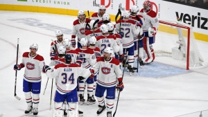 Montreal Canadiens celebrate after defeating the Vegas Golden Knights 4-1 in Game 5 of an NHL hockey Stanley Cup semifinal playoff series Tuesday, June 22, 2021, in Las Vegas. (AP Photo/David Becker)