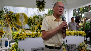 """Former Philippine President Benigno Aquino III addresses supporters following a mass at the tombs of his parents, the late President Corazon """"Cory"""" Aquino, left, and assassinated opposition Senator Benigno Aquino Jr., to commemorate the 10th Death Anniversary of the late President Thursday, Aug. 1, 2019 in suburban Paranaque city south of Manila, Philippines. (AP Photo/Bullit Marquez)"""