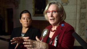 FILE - Minister of Justice and Attorney General of Canada Jody Wilson-Raybould, left, looks on as Minister of Indigenous and Northern Affairs Carolyn Bennett speaks about the Canadian Human Rights Tribunal regarding discrimination against First Nations children in care during a news conference on Parliament Hill in Ottawa, Tuesday, January 26, 2016. THE CANADIAN PRESS/Adrian Wyld