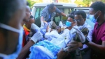 In this image made from video, an injured victim of an alleged airstrike on a village arrives in an ambulance at the Ayder Referral Hospital in Mekele, in the Tigray region of northern Ethiopia, Wednesday, June 23, 2021. An airstrike hit a busy market in Ethiopia's northern Tigray village of Togoga on Tuesday and killed at least 51 people, according to health workers who said soldiers blocked medical teams from traveling to the scene. (AP Photo)