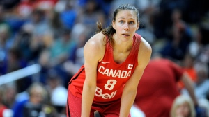 """FILE- In this July 29, 2016, file photo, Canada's Kim Gaucher watches during a break in the second half of a women's exhibition basketball game in Bridgeport, Conn. Gaucher say she is being """"forced to decide between being a breastfeeding mom or an Olympic athlete."""" COVID-19 rules prevent her from bringing her daughter, Sophie, who was born in March, to the Tokyo Olympics next month. She says Olympic organizers have said """"no friends, no family, no exceptions."""" The 37-year-old Gaucher is looking into options, such as shipping milk, but has run into complications. (AP Photo/Jessica Hill, File)"""