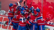 Montreal Canadiens players celebrate after defeating the Vegas Golden Knights following overtime NHL Stanley Cup playoff hockey semifinal action Thursday, June 24, 2021 in Montreal. THE CANADIAN PRESS/Ryan Remiorz