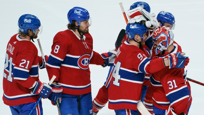 Montreal Canadiens' Eric Staal, Ben Chiarot and Corey Perry, left to right, celebrate their victory with goaltender Carey Price following overtime game 6 NHL Stanley Cup playoff hockey semifinal action against the Vegas Golden Knights, in Montreal, Thursday, June 24, 2021. THE CANADIAN PRESS/Paul Chiasson