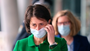 """New South Wales Premier Gladys Berejiklian prepares to address a press conference in Sydney, Thursday, June 24, 2021. Berejiklian says Sydney is going through one the """"scariest"""" times of the pandemic as a cluster of the highly-contagious Delta variant continues to spread. (Dean Lewins/AAP Image via AP)"""