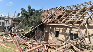 Damaged houses are seen after a tornado hit the village of Moravska Nova Ves in the Breclav district, South Moravia, Czech Republic, on Friday, June 25, 2021. A rare tornado tore through southeastern Czech Republic, killing a few people and injuring hundreds, rescue services said on Friday. (Vaclav Salek/CTK via AP)