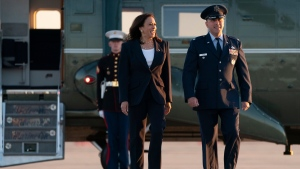"""Vice President Kamala Harris, left, walks with Lt. Col Richard """"Rick"""" Hulun, 89th Maintenance Group Deputy, as she arrives to board Air Force Two, Friday, June 25, 2021, at Andrews Air Force Base, Md., en route to El Paso, Texas. (AP Photo/Jacquelyn Martin)"""