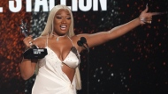Megan Thee Stallion accepts the best female hip hop artist award at the BET Awards on Sunday, June 27, 2021, at the Microsoft Theater in Los Angeles. (AP Photo/Chris Pizzello)