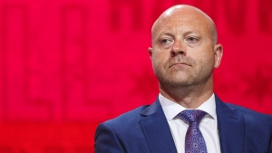 In this July 26, 2019, file photo, Chicago Blackhawks senior vice president and general manager Stan Bowman attends the NHL hockey team's convention in Chicago. Bowman has pledged to participate in and cooperate with an investigation into allegations that a former Chicago Blackhawks assistant coach sexually assaulted two players in 2010. (AP Photo/Amr Alfiky, File)