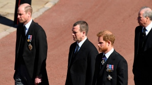 From left, Britain's Prince William, Peter Phillips and Prince Harry during the procession ahead of Britain Prince Philip's funeral at Windsor Castle, Windsor, England, Saturday April 17, 2021. Prince Philip died April 9 at the age of 99 after 73 years of marriage to Britain's Queen Elizabeth II. (Jeremy Selwyn/Pool via AP)