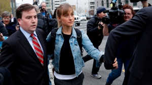 Allison Mack leaves Federal court in the Brooklyn borough of New York on April 24, 2018. Mack, an actress best known for playing a young Superman's friend, was sentenced to 3 years in prison for role in NXIVM sex-slave case. (AP Photo/Frank Franklin II, File)