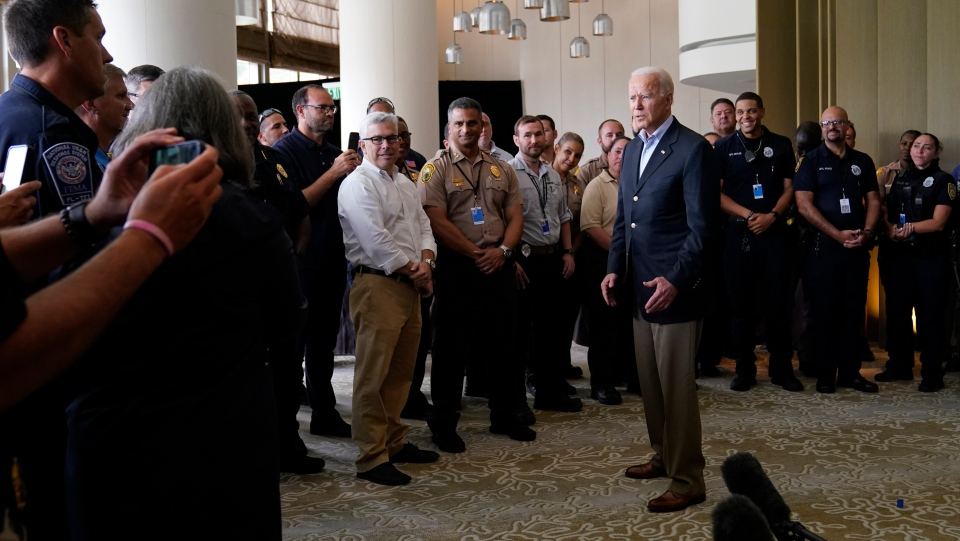 President Joe Biden meets with first responders in Miami Beach, Fla., Thursday, July 1, 2021, who were working on the condo tower that collapsed in Surfside, Fla., last week. (AP Photo/Susan Walsh)