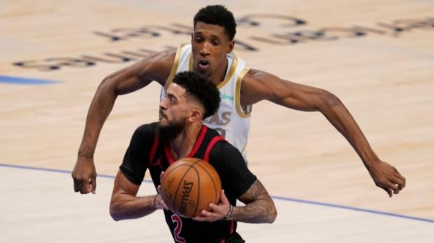 Toronto Raptors' Jalen Harris (2) sprints to the basket past Dallas Mavericks guard Josh Richardson (0) in the second half of an NBA basketball game in Dallas, Friday, May 14, 2021. (AP Photo/Tony Gutierrez)