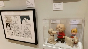A new exhibit on dogs in cartoons and comic strips includes vinyl toys of Charlie Brown and Snoopy and Dennis the Menace and Ruff, from the private collection of exhibit curator Brian Walker, in a photo taken Thursday, June 24, 2021, in Columbus, Ohio. The genesis for the exhibit, which runs through October, came when the late Brad Anderson, the creator of Marmaduke, donated his collection in 2018, including 16,000 original Marmaduke cartoons from 1954 to 2010. (AP Photo/Andrew Welsh-Huggins)