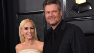 In this Jan. 26, 2020, file photo, Gwen Stefani, left, and Blake Shelton arrive at the 62nd annual Grammy Awards in Los Angeles. (Photo by Jordan Strauss/Invision/AP, File)