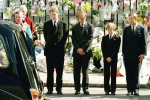 Prince Charles with his two sons Prince Harry second from right, and Prince William third from right, and Earl Spencer bow their heads as they watch the hearse bearing the coffin of Diana leave Westminster Abbey on Sept. 6, 1997. (AP / Jeff J. Mitchell)