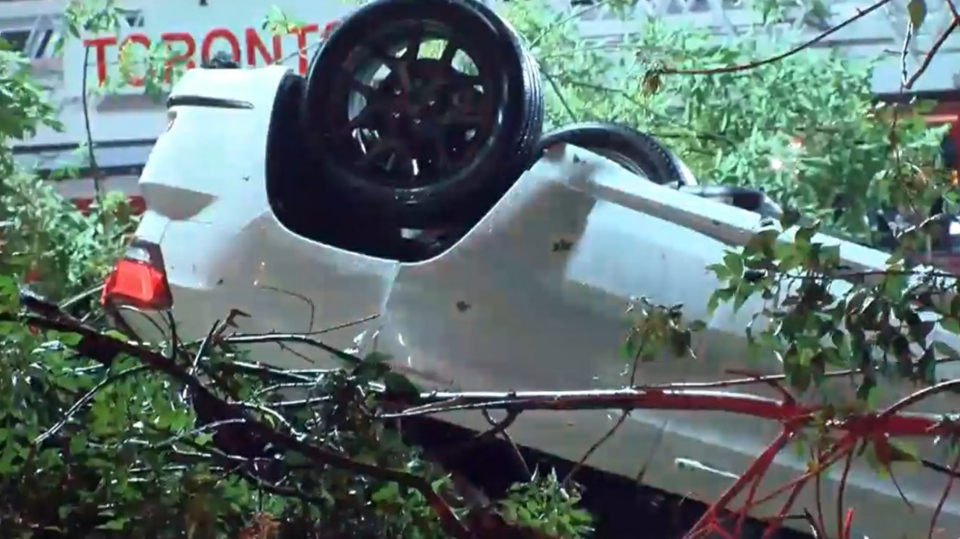 A vehicle is seen on its roof outside the Etobicoke KIA dealership on July 7, 2021. (CP24)