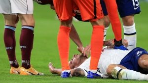 Tottenham's Toby Alderweireld is checked by fellow players after injuring his head during the English Premier League soccer match between Burnley and Tottenham Hotspur at Turf Moor stadium, Burnley, England, in this Monday, Oct. 26, 2020, file photo. Toronto researchers have developed a tool they say can help doctors determine who is most likely to suffer concussion symptoms that persist months after injury. THE CANADIAN PRESS/AP-Lindsey Parnaby/Pool via AP, File