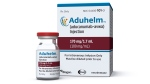 This image provided by Biogen on Monday, June 7, 2021 shows a vial and packaging for the drug Aduhelm. (Biogen via AP, File)