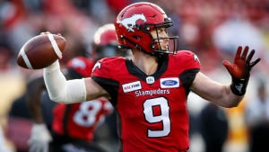 FILE - Calgary Stampeders quarterback Nick Arbuckle, throws the ball during second half CFL football action against the Toronto Argonauts, in Calgary, Thursday, July 18, 2019. THE CANADIAN PRESS/Jeff McIntosh