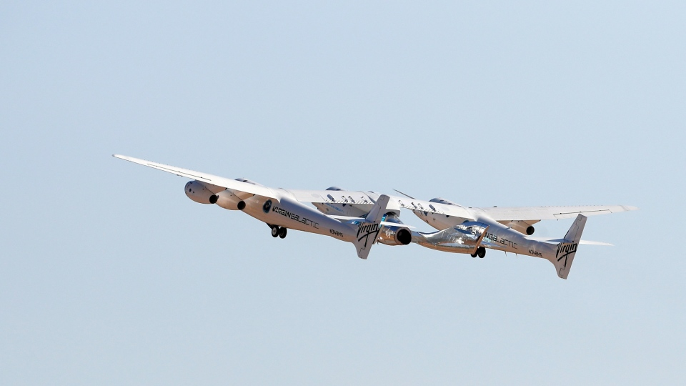The rocket plane carrying Virgin Galactic founder Richard Branson and other crew members flies toward space from Spaceport America near Truth or Consequences, N.M., Sunday, July 11, 2021. (AP Photo/Andres Leighton)