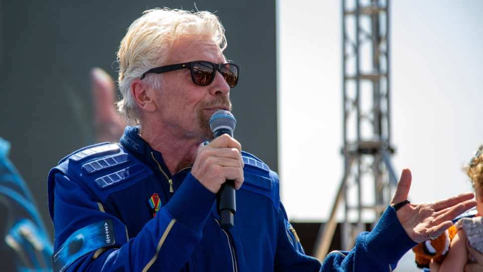 Virgin Galactic founder Richard Branson speaks to the crowd while celebrating their flight to space from Spaceport America near Truth or Consequences, N.M., Sunday, July 11, 2021. (AP Photo/Andres Leighton)