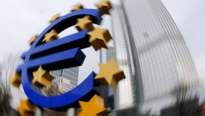 In this Tuesday, March 18, 2014 file photo while turning the camera, the Euro sculpture stands in front of the European Central Bank in Frankfurt, Germany. (AP Photo/Michael Probst, File )