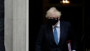 British Prime Minister Boris Johnson leaves 10 Downing Street to attend the weekly Prime Minister's Questions at the Houses of Parliament, in London, Wednesday, July 14, 2021. (AP Photo/Matt Dunham)
