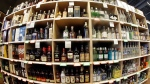 FILE - This June 16, 2016 file photo made with a fisheye lens shows bottles of alcohol during a tour of a state liquor store in Salt Lake City. (AP Photo/Rick Bowmer, File)