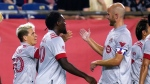 Toronto FC midfielder Yeferson Soteldo, left, is congratulated by midfielder Michael Bradley, right, after his goal in the first half of an MLS soccer match against the New England Revolution, Wednesday, July 7, 2021, in Foxborough, Mass. At center is Toronto FC forward Ayo Akinola. (AP Photo/Charles Krupa)