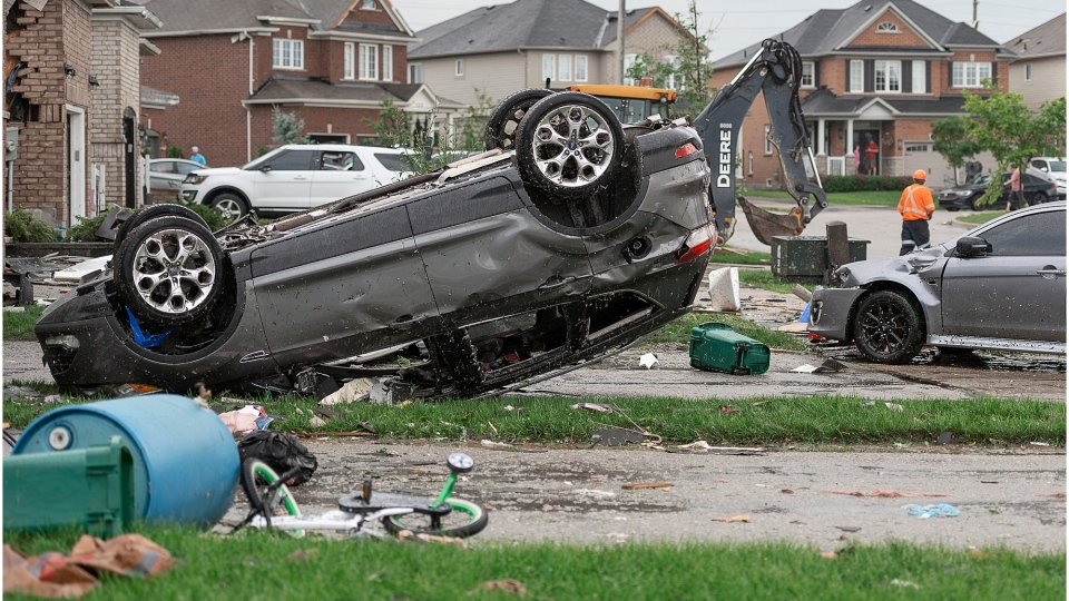 An overturned car is pictured after a suspected tornado touched down in Barrie, Ont. Thursday, July 15, 2021. (Courtesy: Stephen Elliott)